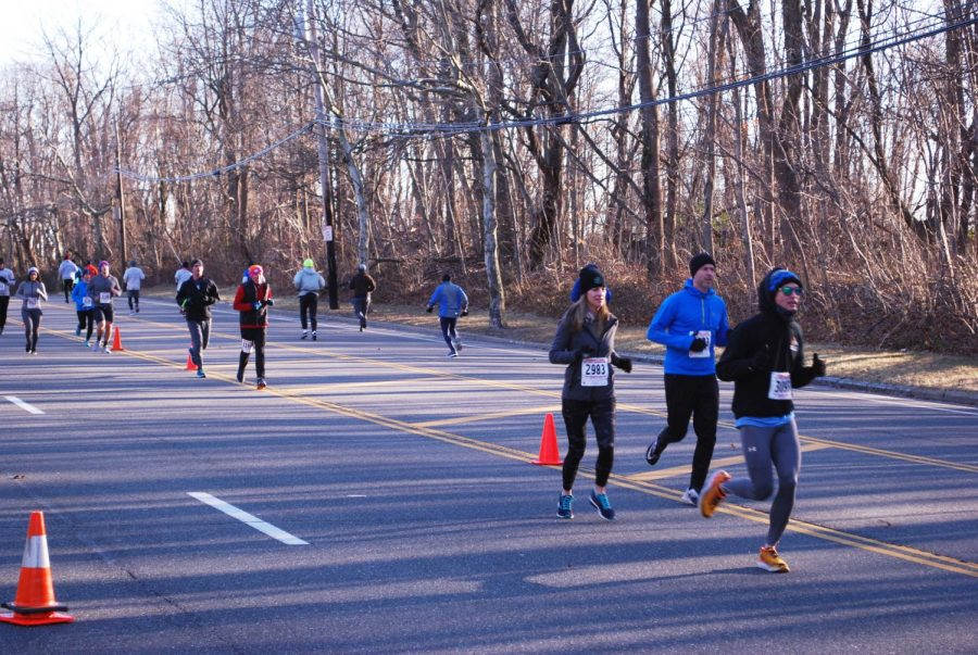 Runners+participate+in+Port+Washington%27s+first-ever+five+mile+winter+run+hosted+by+the+Community+Chest.