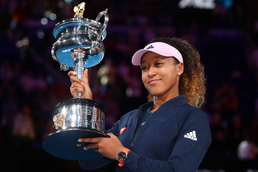 Naomi+Osaka+receives+her+trophy+after+winning+the+women%27s+singles+final%2C+defeating+Petra+Kvitova+in+three+sets.