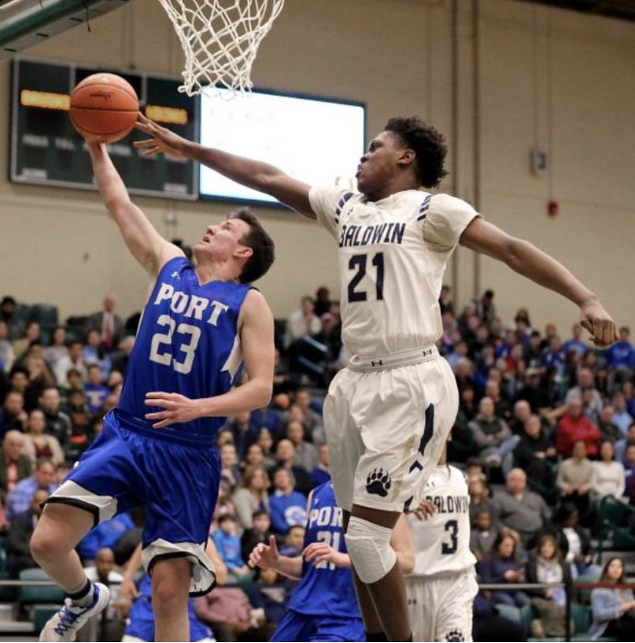 Senior Marc Daly goes up for a lay-up in the county semifinals on Feb. 26 against Baldwin. The boys won by a score of 45-39.
