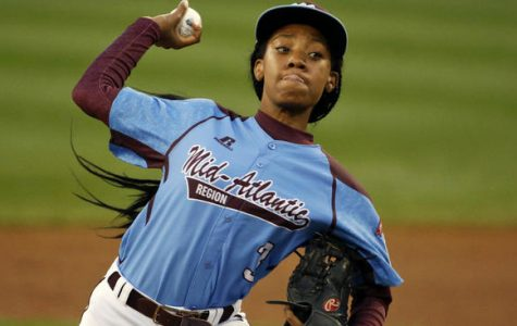 Mo'ne Davis throwing a fastball in the Little League World Series. She will now attend Hampton University to play softball.