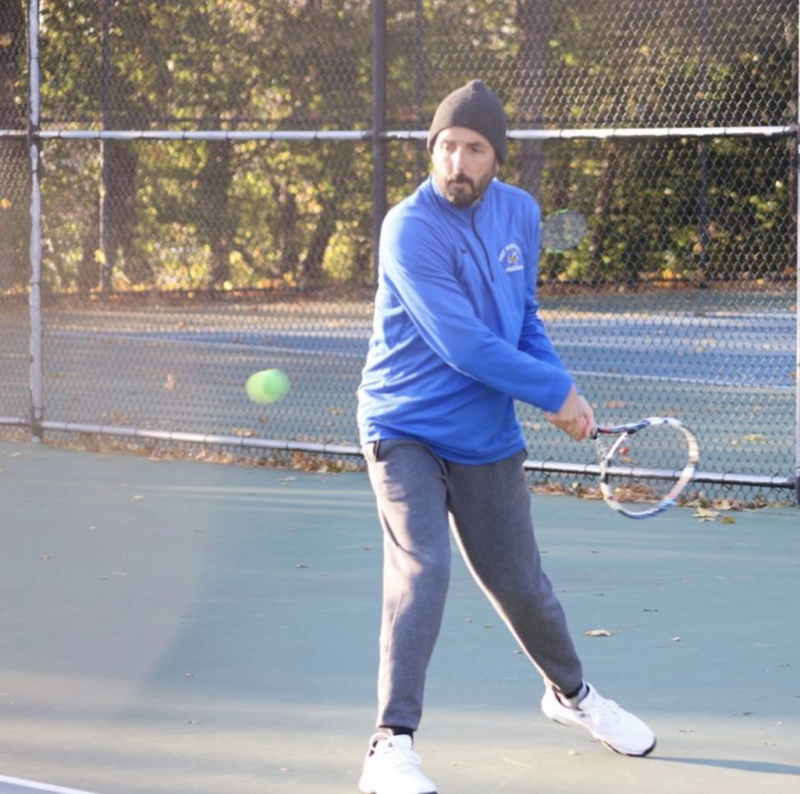 Superintendent+Dr.+Michael+Hynes+prepares+to+hit+a+backhand+in+an+intense+doubles+match+with+partner+senior+Charlotte+Forman.