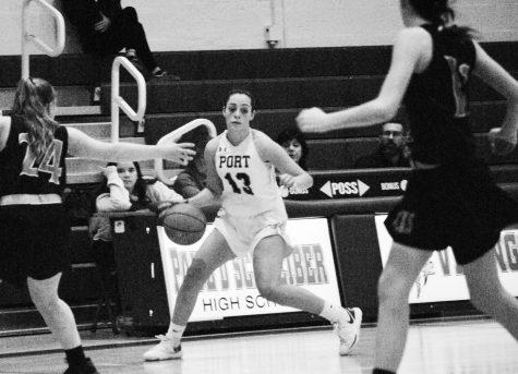 Freshman Natalie DeMeo tries to move the ball against the East Rockaway defense.  Port Washington won the game 42-30 on Dec. 12